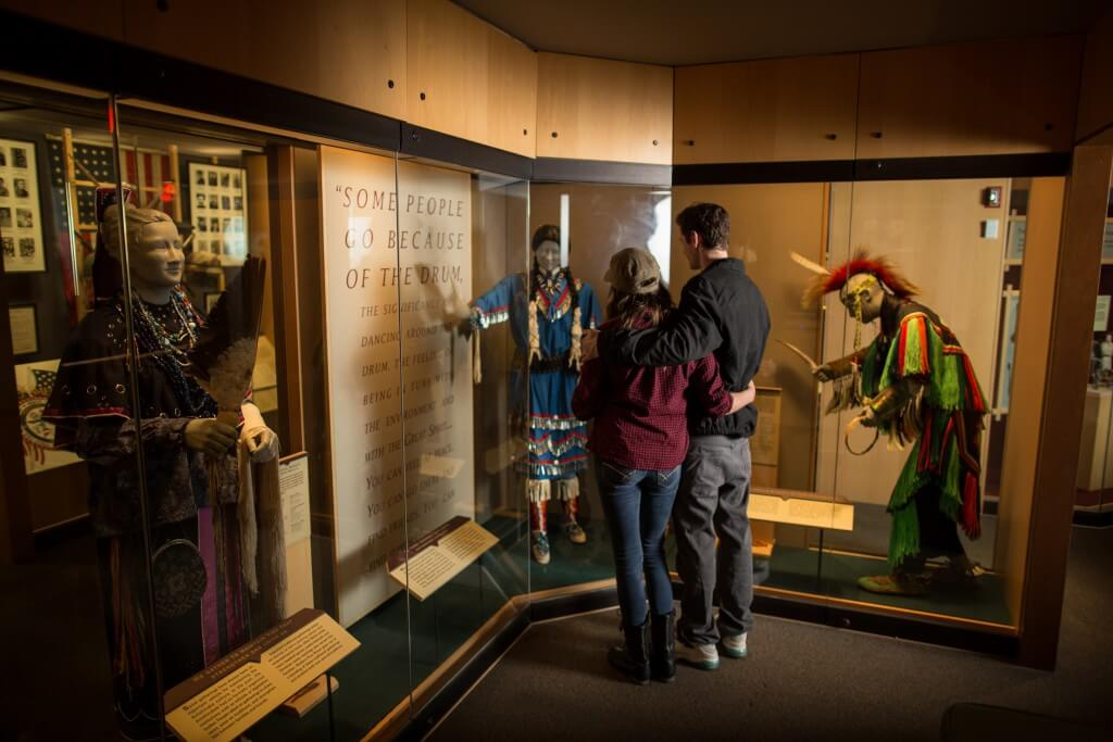 A couple looking at the Portraits exhibits