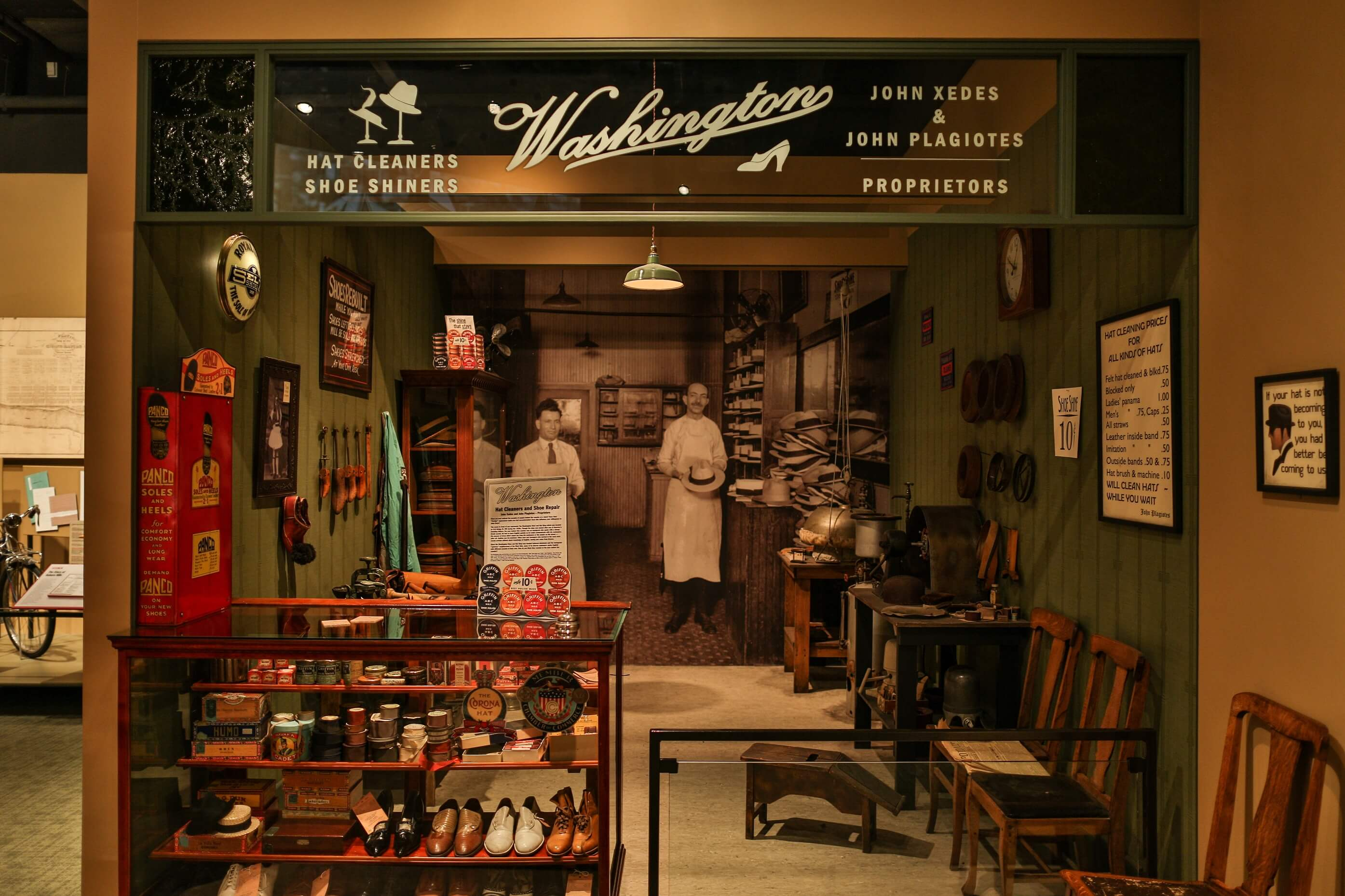 Hat cleaners and shoe shiners store of the Newcomers: People of This Place exhibition
