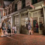 Visitors walk through the Streets of Old Grand Rapids exhibit