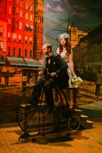 Bride and Groom ride 1890s bicycle in Streets of Old Grand Rapids
