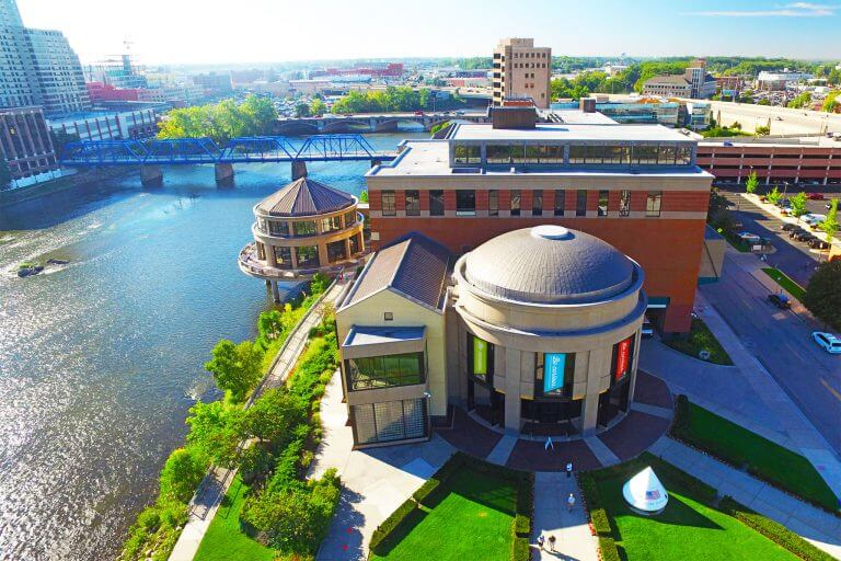 Grand Rapids Public Museum Exterior Aerial Photo with Be Curious banners