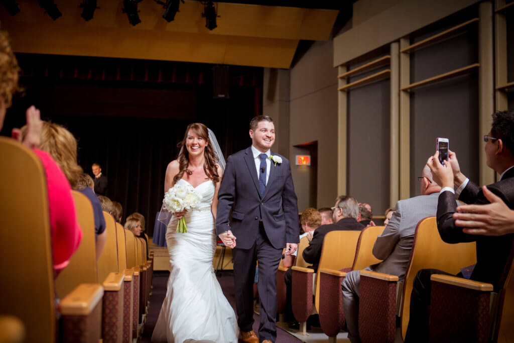 Bride and Groom leaving ceremony in Meijer Theater