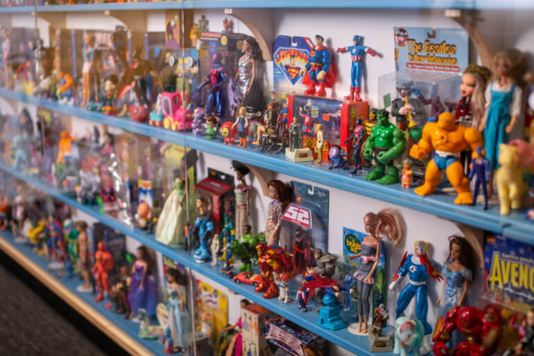Close up image of TOYS wall with 500 different toy figures