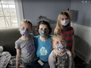 The Mervaus kids wearing face masks during COVID 19 stay at home order