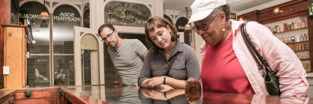 Visitors explore the pharmacy in the Streets of Old Grand Rapids exhibit